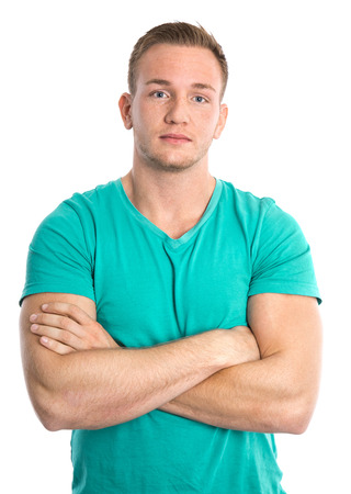 buff: Cool blond  isolated young sportive blond man in green shirt. Stock Photo