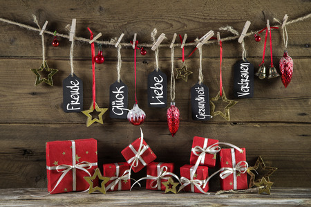 good wishes: Emotional christmas greeting card with red presents and good wishes in german language: fun, luck, love, health and confidence.