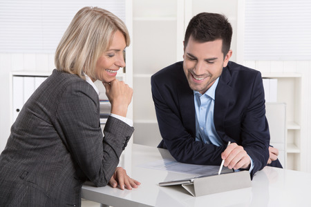 career counseling: Successful business team or costumer and client in a meeting or discussion. Stock Photo