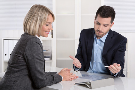 Successful business team or costumer and client in a meeting or discussion. Stock Photo