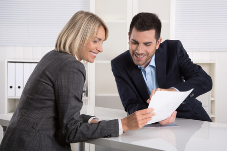 costumer: Successful business team or costumer and client in a meeting or discussion. Stock Photo
