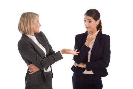 languages: Dos aislado mujer de negocios hablando juntos. Foto de archivo