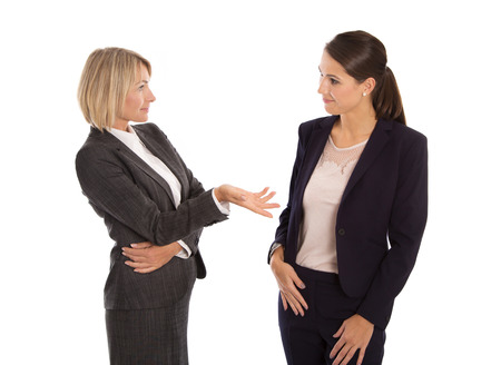 Two isolated business woman talking together.