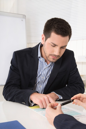outgoings: Customer or businessman in a meeting or adviser with customer looking at the form of statistics. Stock Photo