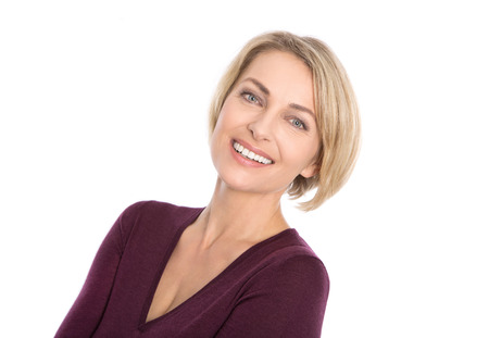 Lucky isolated blond mature woman with white teeth and red pullover in color.