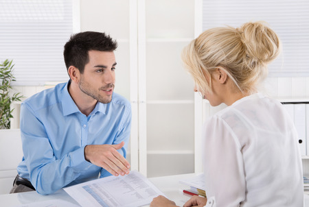 Professional business meeting: consultant explain his female customer the risc and possibilities of provision for one's old age.