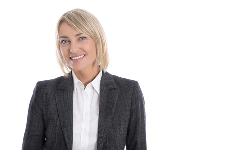 older age: Portrait: Successful isolated older or mature blond business woman in blazer and white blouse. Stock Photo
