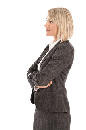Attractive isolated mature business woman wearing costume and blouse looking sideways to text.