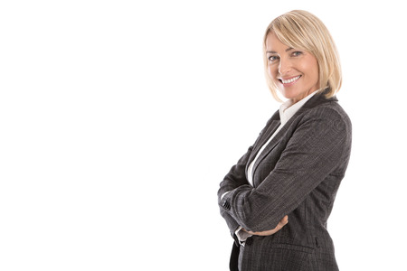 Portrait: Successful isolated older or mature blond business woman in blazer and white blouse. Stock Photo