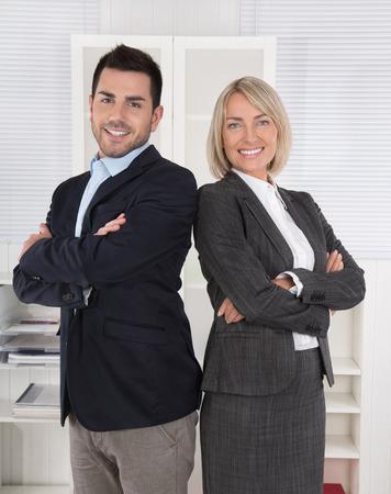 advocates: Successful male and female business team: senior and junior managing directors.