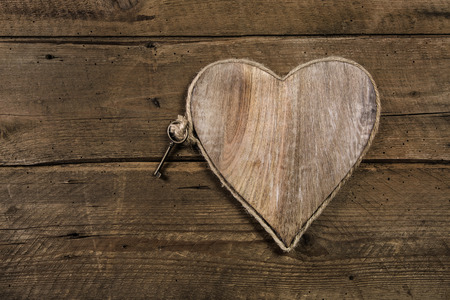 wedding wishes: Rustic old wooden background with a key. Idea for a greeting card. Stock Photo