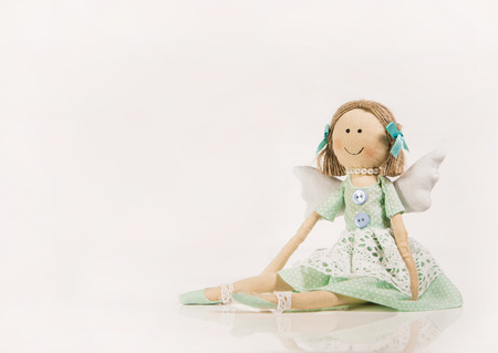 angel figurine: Isolated Doll or puppet like a guardian angel for decoration.
