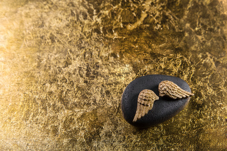 stone background: Black stone with golden wings for a elegant background.