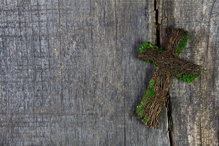 condolence: Wooden cross on a background for a condolence card.