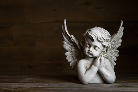 Sad angel figure: idea for a greeting or condolence card.