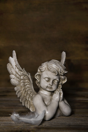 condolence: Sad angel figure: idea for a greeting or condolence card.