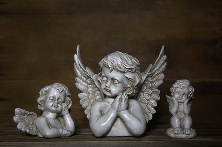 bereavement: Three sad angels: decoration for bereavement or idea for a condolence card.