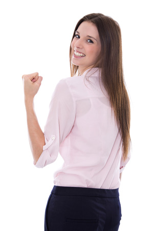 Power and Success: Isolated lucky and young business woman over white background. photo