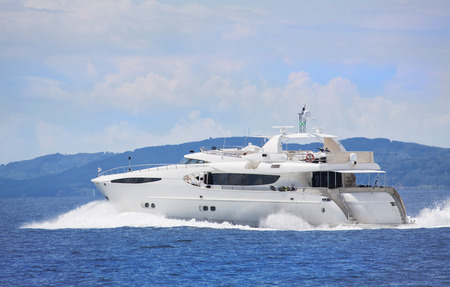motor yacht: Luxury and expensive motorized yacht in the sea or blue ocean.
