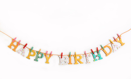 felicitation: Happy birthday text with wooden shabby chic letters on a white background. Stock Photo
