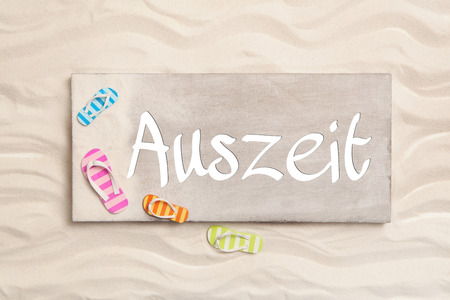 auszeit: German word Auszeit what means time out. Summer holiday concept for publicity and promotion.