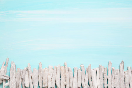 oceanic: Blue or turquoise oceanic background with a fence of driftwood. Maritime items.
