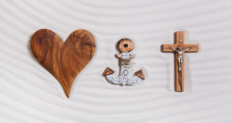 godly: The three symbols of the devine trinity: heart, anchor, cross. Concept for religious items.