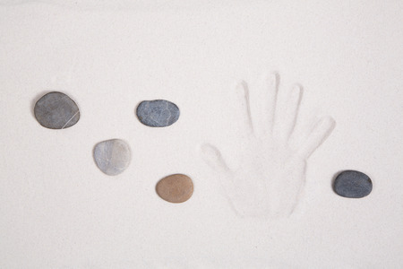 Meditation concept with hand and stones.