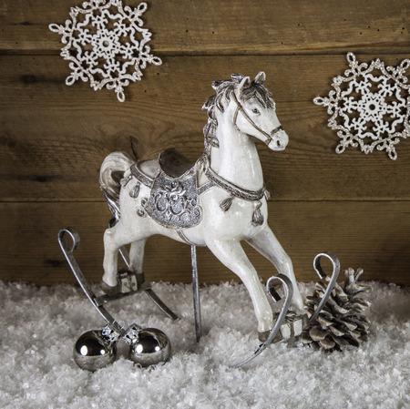 nostalgic christmas: Old rocking horse in white and silver for nostalgic christmas decoration.