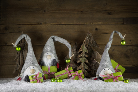 Funny handmade christmas decoration in red, white, green, brown and red with gifts, imps and balls. Foto de archivo
