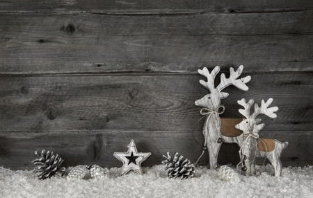 Wooden christmas background in shabby chic style in grey and white with moose.