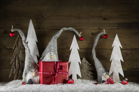 funny natural christmas decoration in grey white and red with gift boxes and imps on