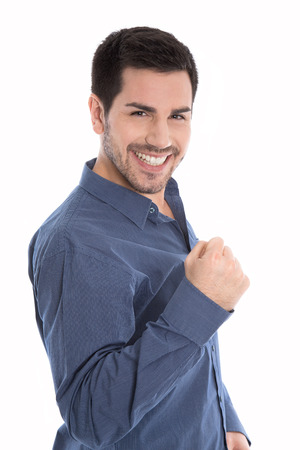 reached: Proud and happy young business man making fist isolated over white.