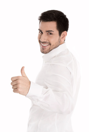 brunett: Successful brunett man isolated over white with thumbs up gesture. Stock Photo