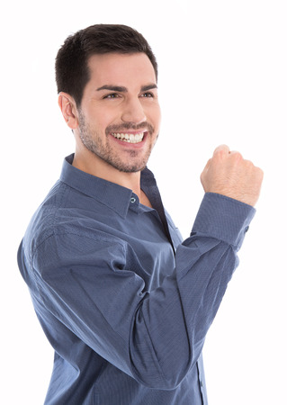 Proud and happy young business man making fist isolated over white. Banco de Imagens - 42962139