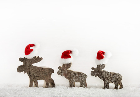 humorously: Three wooden handmade santa on a background with place for text.
