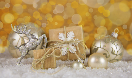 christmas gold: Christmas decoration in gold, silver and white with gift boxes in the snow.