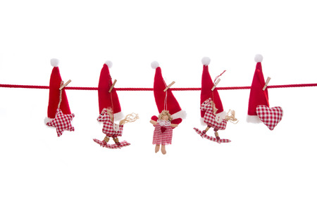 clothes pegs: Isolated christmas decoration in red white checked colors with handmade figurines.