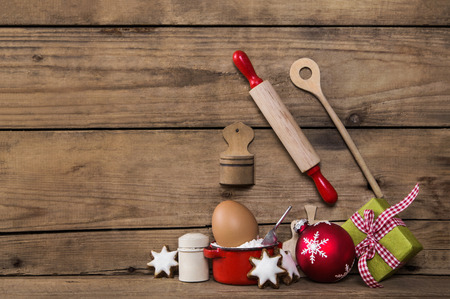 advent time: Baking in advent time. Wooden background with kitchen utensils for cookies and cakes.