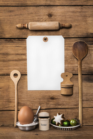 Baking in advent time. Wooden background with kitchen utensils for cookies and cakes.