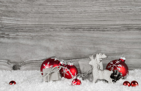 xmas background: Grey wooden background with white and red classical xmas decoration. Stock Photo