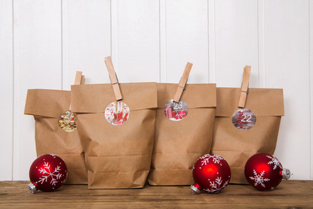 tinkered: Tinkered advent calendar with paper bags and clothes peg. Stock Photo