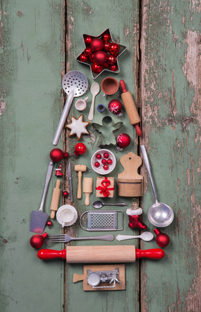 christmas catering: Antique and rustic children toys decoration for christmas in form of a tree in red , silver, green and brown colors.