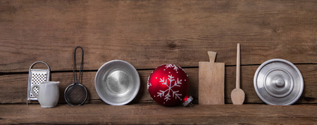 antique background: Old antique kitchen miniatures on wooden background for christmas decoration.
