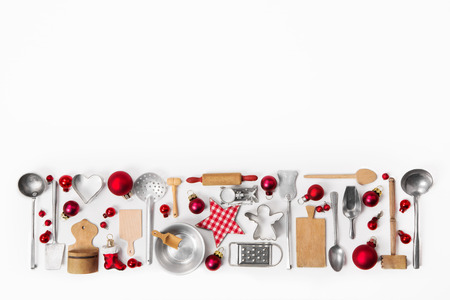 Xmas decoration of old red, white and silver cutlery and dishes.