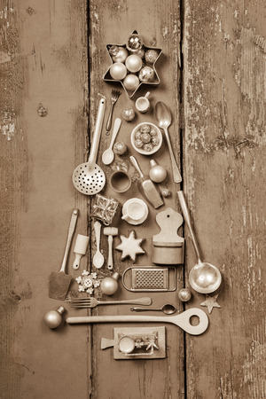 old fashioned: Christmas tree of many vintage kitchen miniatures for decoration.