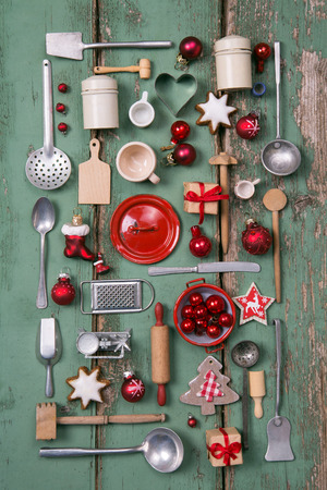 red kitchen: Country style or wooden vintage Christmas background in red and green for kitchen and menu decoration. Stock Photo