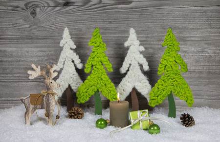 tinkered: Country-style christmas decoration in grey, white, brown and green colors.