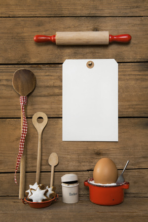 utensils: White sign on an old wooden background with backing christmas decoration utensils. Stock Photo