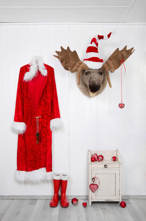 santa moose: Humorously classical santa christmas decoration background in red and white colors.